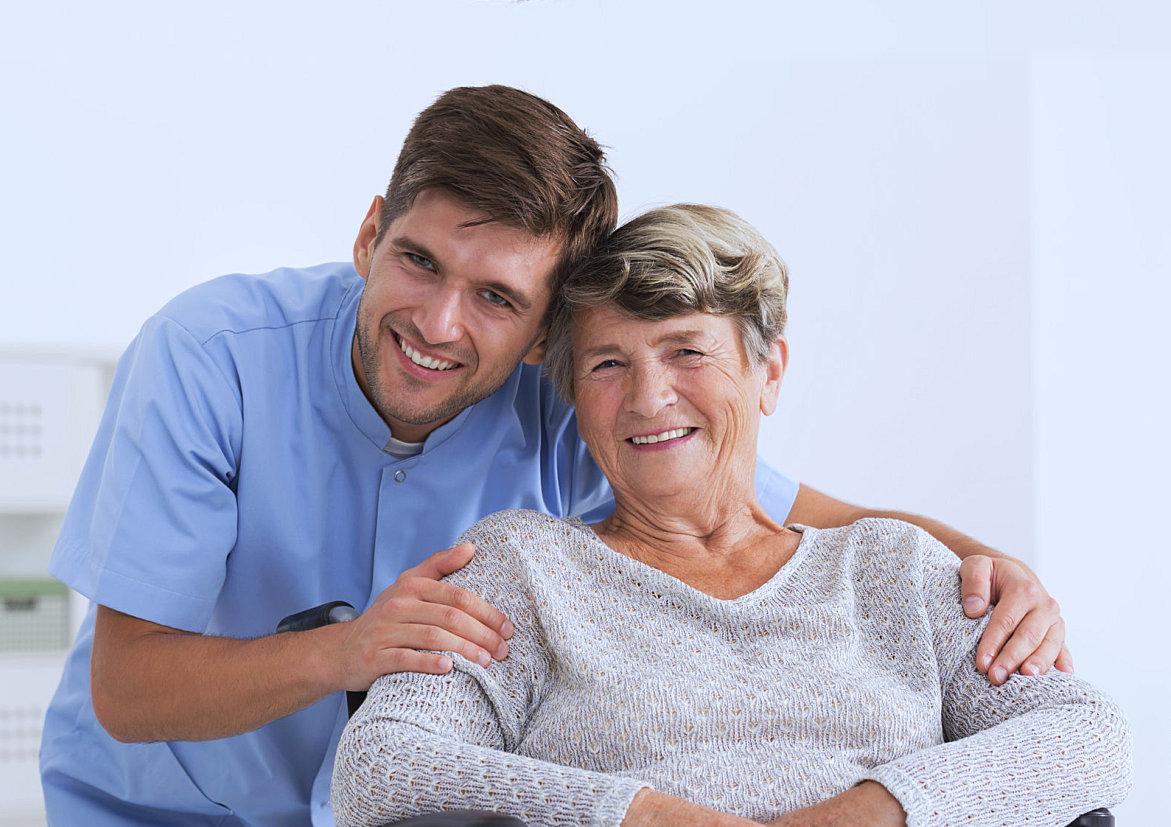 caregiver hugging an elder woman