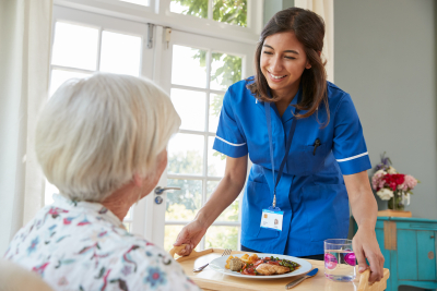 nurse serving senior woman